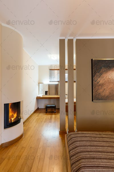 Bedroom with fireplace and dressing room