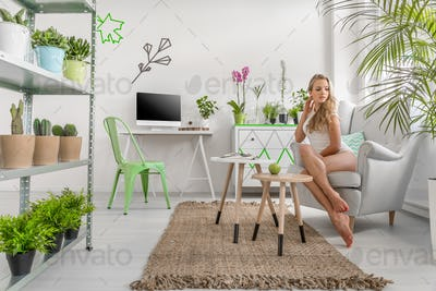 Young woman sitting in  armchair in a stylish room