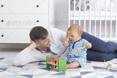 Father playing with his baby