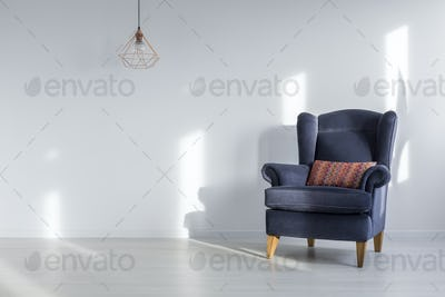 Interior with blue armchair
