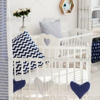 Newborn's crib with soft decorations
