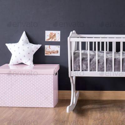 Stylish cradle with star cushion