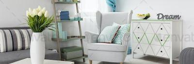 Cosy reading corner in light living room