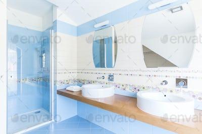 Blue bathroom with double sinks