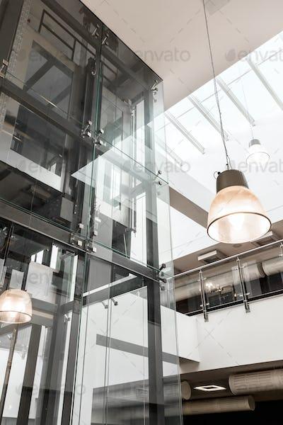 Glass elevator in modern building