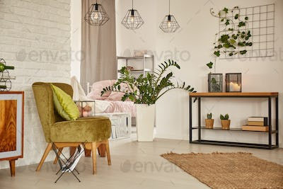 White interior with green armchair