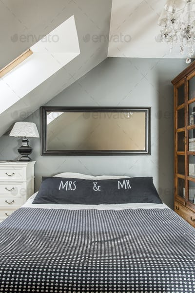 Stylish bedroom with a double bed