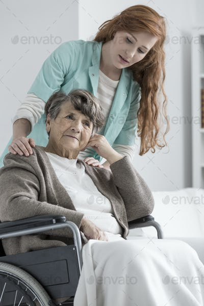 Senior supported by nurse