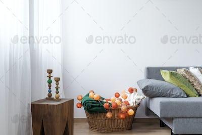 Room corner with wicker basket