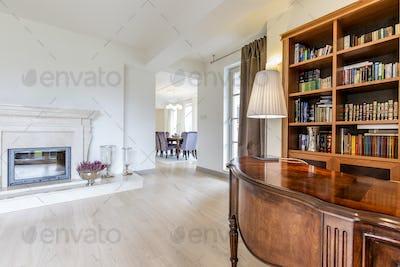 Elegant office with hardwood desk and bookcase