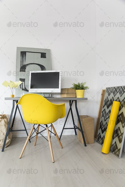 Workplace with yellow chair