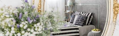 Grey bedroom with rustic mirror