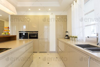 Spacious bright kitchen with fitted cabinets