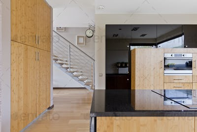 Spacious kitchen with wooden furnitures