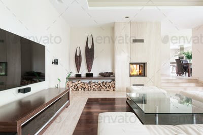White living room with TV set