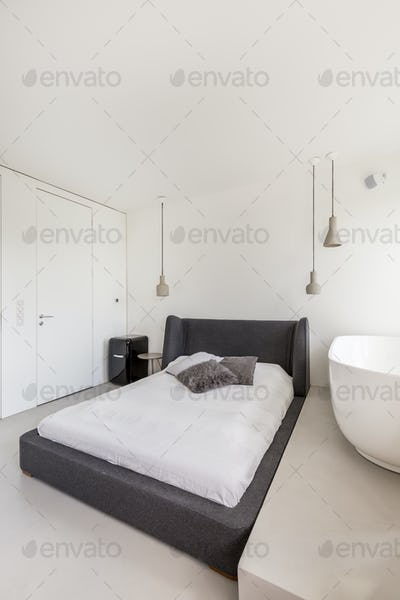 White bedroom with simple bed