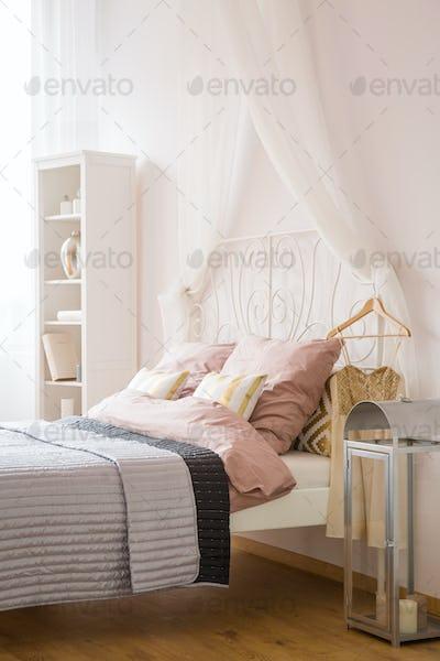 White bedroom with decorative lantern
