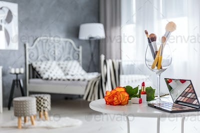Table with makeup accessories