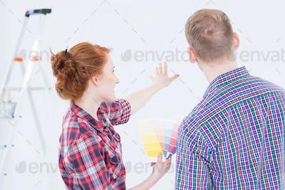 Woman choosing the wall colour