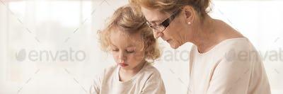 Elderly nanny with little boy