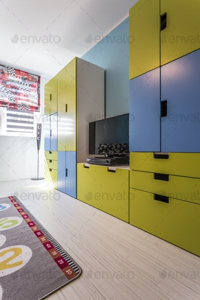 Room with colourful built-in furniture