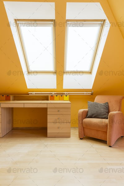 Room in warm colours with desk