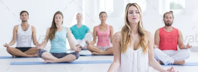 People meditating with closed eyes