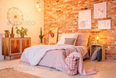 Warm bedroom with brick wall