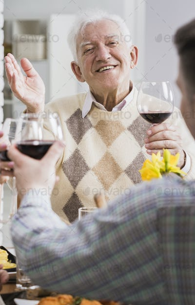 Man and elderly father making a toast