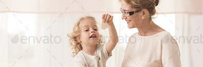 Grandma baking cookies with grandson