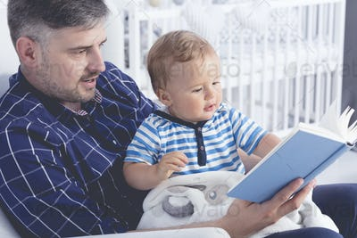 Father with baby reading a book