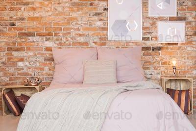 Loft bedroom with brick wall