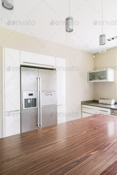 Spacious kitchen with wooden table top