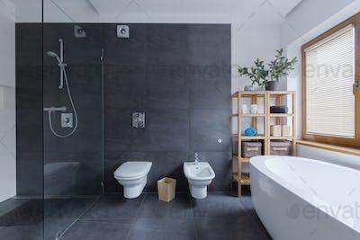 Glass shower in travertine bathroom