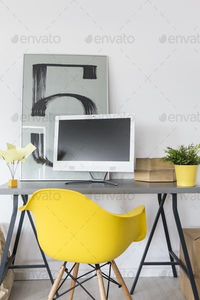 Desk, computer and yellow chair