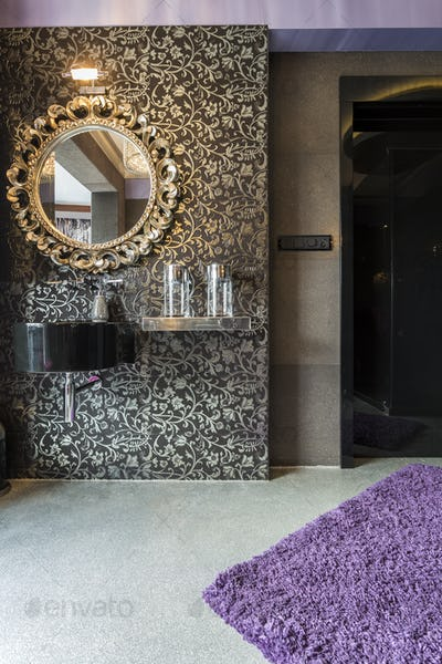 Glamorous room with mirror on silver wall