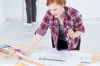 Woman designer with interior projects