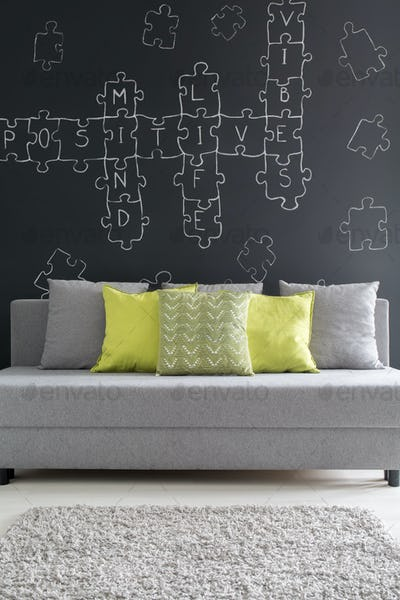 Grey sofa with green cushions