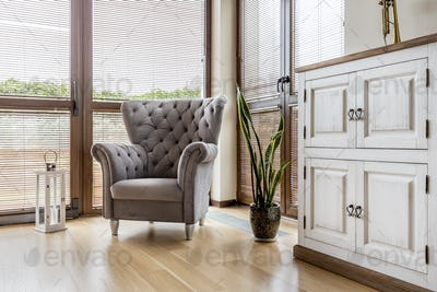 Cosy living room with comfortable armchair