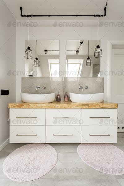 Two sinks and cabinet in bathroom