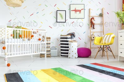 Baby room with yellow chair