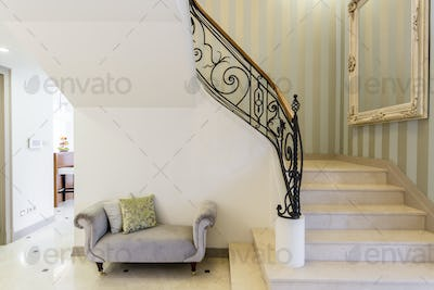 Elegant staircase with decorative railing