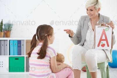 Speech therapist and child