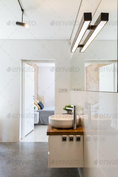 High gloss white bathroom idea
