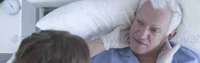 Physician examining senior patient