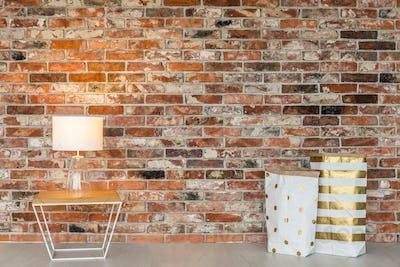 Brick wall and gift bags