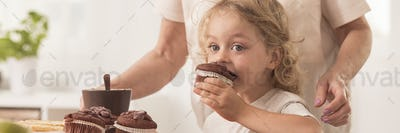 Boy eating chocolate muffins