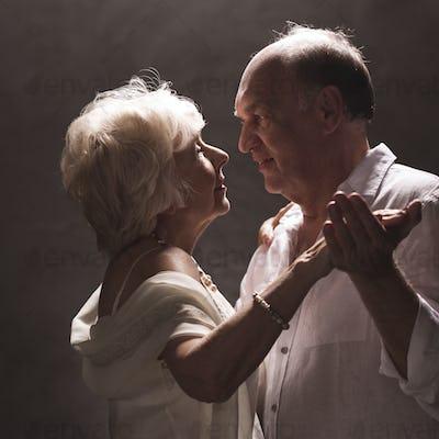 Senior stylish couple dancing
