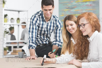 Creative workers at modern interior