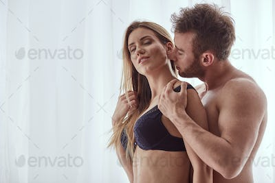 Man kissing the woman